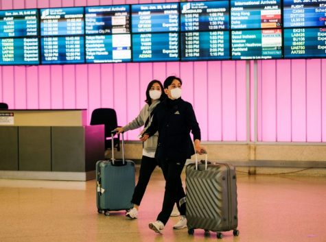 Passengers arrive at LAX from Shanghai, China, after a positive case of the coronavirus was announced in Orange County.